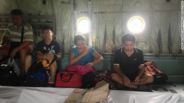 The team caught a flight from Tacloban to Cebu after trying to find a way out of the devastaated city. Reynolds said the atmosphere aboard the C-310 was somber as survivors sat on the ground alongside four body bags.
