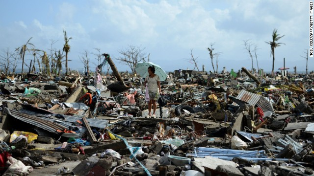 A woman in Tacloban walks amid the debris of destroyed houses on November 11.