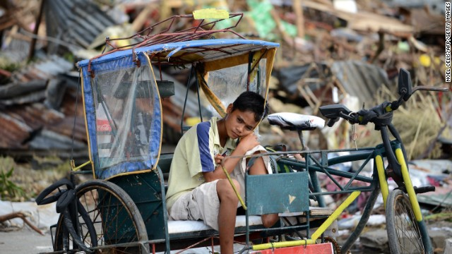A young survivor rests on a pedicab November 11 in Tacloban.