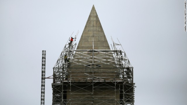 Workers finish installing the last pieces of scaffolding in May.