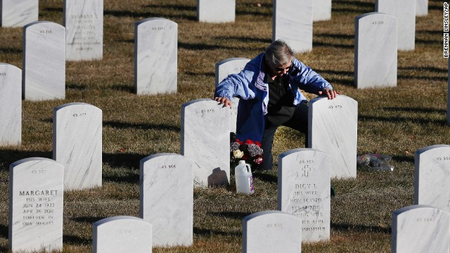 Berna Brown visits the grave of her husband on Veterans Day -- Monday, November 11 -- at Fort Logan National Cemetery in Denver. Robert E. Brown served in World War II, Korea and Vietnam.