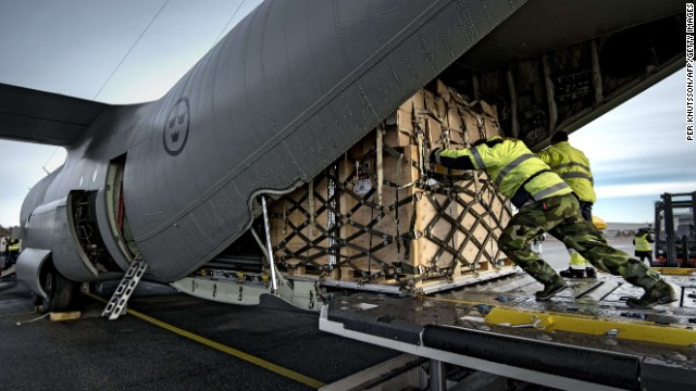 Staff load a Hercules airplane with equipment November 11 at the Orebro airport in central Sweden. The Swedish Civil Contingencies Agency, together with its humanitarian partners, sent equipment to support the United Nations' relief work in the Philippines.