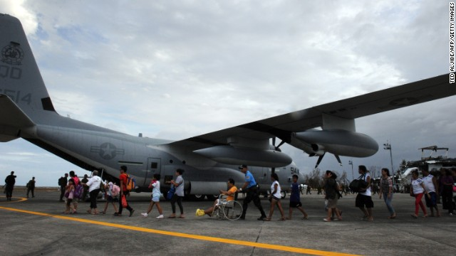 Survivors in Tacloban board a military plane bound for the Philippine capital of Manila on November 11.