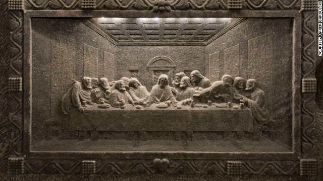 A frieze of 'The Last Supper' carved into the side of a subterranean cave at the Wieliczka salt mine.