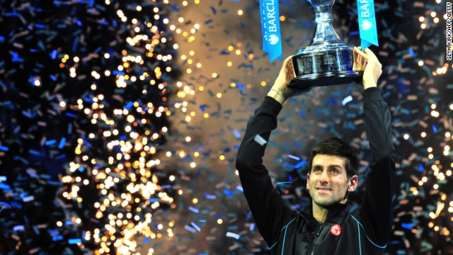 Novak Djokovic lifts the Brad Drewett trophy after beating Rafael Nadal in the final of the ATP World Tour Finals.