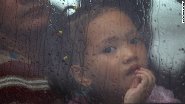 A girl sits inside a bus as she waits for a ferry in Matnog, Philippines, on November 12.
