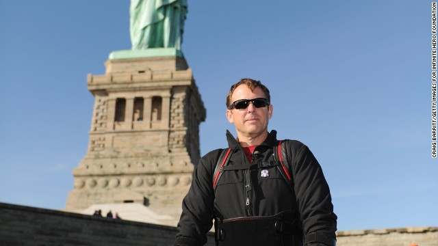 Paralyzed since 2008, veteran Gary Linfoot took a walk around the Statue of Liberty with the help of a bionic device.