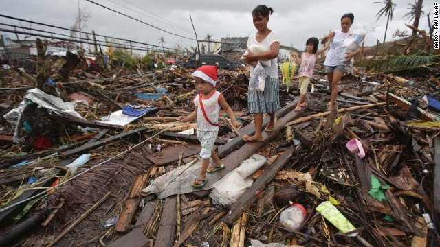 Survivors walk in Tacloban on November 12.