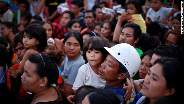 Evacuees wait to board a military aircraft in Leyte on Tuesday, November 12.