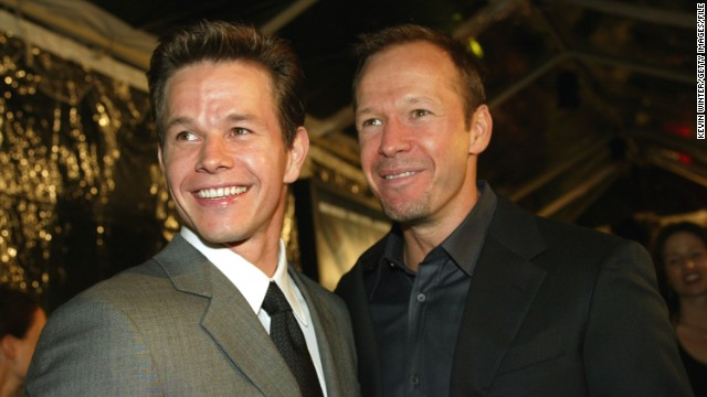 Mark and Donnie Wahlberg attend the 2002 movie premiere of