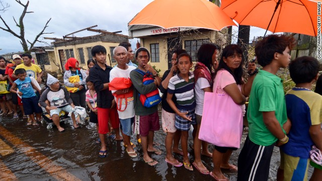 People in Leyte, Philippines, wait in line to receive relief goods Tuesday, November 12.