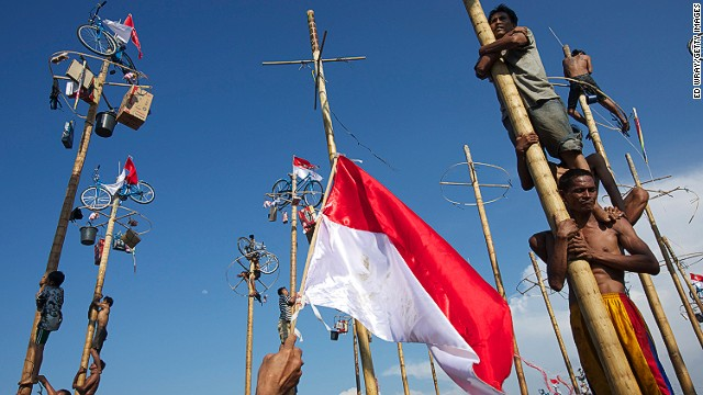 Shaking off Dutch colonial invaders, Indonesian freedom fighters created their flag by tearing the blue strip off a Dutch tricolor. Another version claims the colors are derived from the 14th century Majapahit Empire.