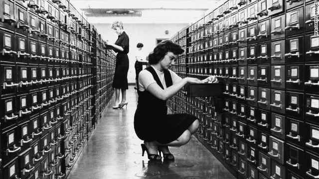 Then: The card catalog was a formidable piece of furniture found at every library. On its thousands of cards: title, author, subject and call number -- sometimes with handwritten notations. Now: Google. The world's knowledge at your fingertips. So much for roaming the aisles of the <a href='http://www.oclc.org/en-US/dewey/resources/summaries.html' target='_blank'>Dewey Decimal System</a>.