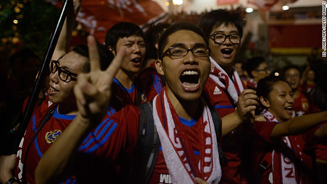 Guangzhou Evergrande fans celebrate after winning the AFC Champions League title in November.