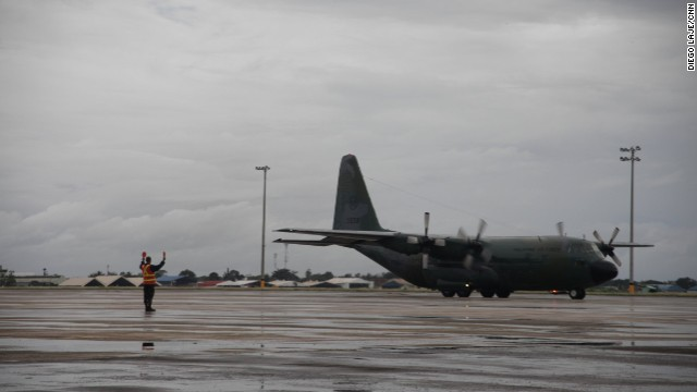 A Philippines Air Force C-130 lands at Mactan base in Cebu International Airport. The plane helped rescue survivors of the tragedy.