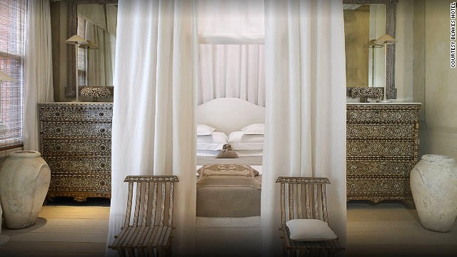 "The Corfu Suite at the <strong>Blakes Hotel</strong> in London won the judges' vote for the sexiest hotel room for its white drapes, mother-of-pearl accents and a four-poster bed ""you can't leave."" Do you agree with the judges?"
