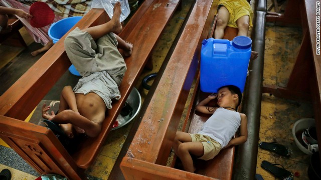 Residents take shelter in a Tacloban church on November 13.