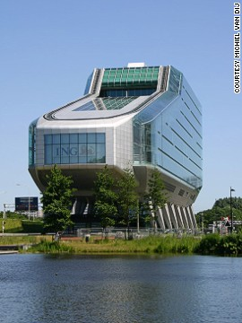 "Architect: Meyer en Van Schooten Architecten.<!-- --> </br>ING House is headquarters to the global financial house ING Group.<!-- --> </br>Due to its unusual shape, the building also has the nicknames ""shoe"" and ""dustbuster."""