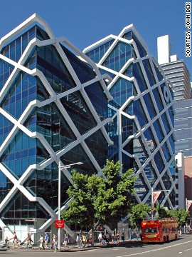 Architect: Fitzpatrick + Partners.<!-- --> </br>Macquarie Bank is headquartered in Sydney, and is Australia's only major bank.<!-- --> </br>A particularly eye-catching aspect of Macquarie Bank Centre is the white lattice structure that sits like a net around the glass cube. A total of 1,000 tonnes of steel girder were used in construction of the building.