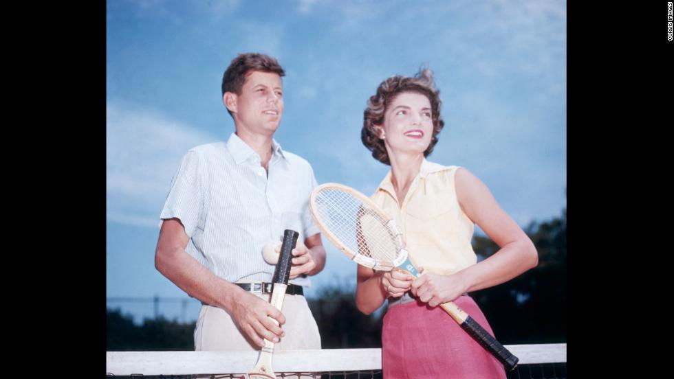 John Fitzgerald Kennedy and his fiancée, Jacqueline Lee Bouvier, playing tennis in 1953. They were history's power couple, a dashing Democrat and an elegant wife. They were both from influential families and became superstars before he entered the White House. Take a look back at the couple that embodied the image of a perfect family.