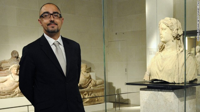"Meet Jean-Luc Martinez, the 49-year-old archeology and art history professor who pretended to be an average tourist -- and spent three-and-a-half hours queuing to get inside the Louvre. ""If you are a professional, there is a risk at certain times you are only going to look at the museum with the eyes of a professional,"" said the museum's new director."