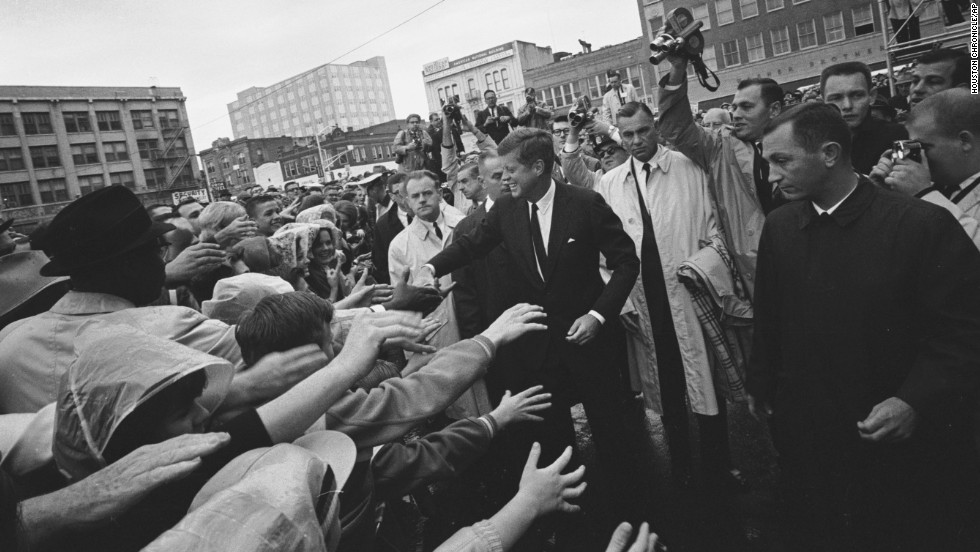 President John F. Kennedy greets supporters during his visit to Fort Worth, Texas, on Friday, November 22, 1963. This year marks 51 years since his assassination in Dallas, an event that jarred the nation and fueled a multitude of conspiracy theories about whether Kennedy was killed by a single gunman acting alone in the Texas School Book Depository. Here are some images from that fateful day as it unfolded.