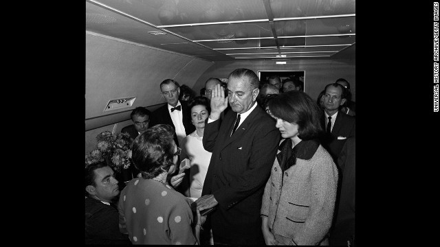 Vice President Lyndon Johnson takes the oath of office to become the 36th president of the United States. He is sworn in by U.S. Federal Judge Sarah T. Hughes, left, with Jacqueline Kennedy by his side on Air Force One.