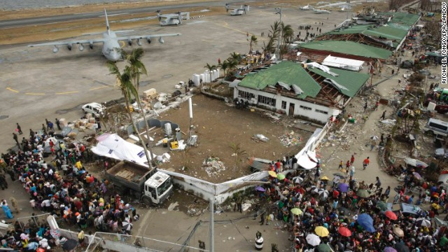 Stranded passengers board a plane in Tacloban on Wednesday, November 13.