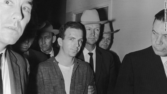 Lee Harvey Oswald, a 24-year-old ex-Marine, is arrested in the back of a movie theater where he fled after shooting Dallas Police Patrolman J.D. Tippit. That incident occurred approximately 45 minutes after the assassination.