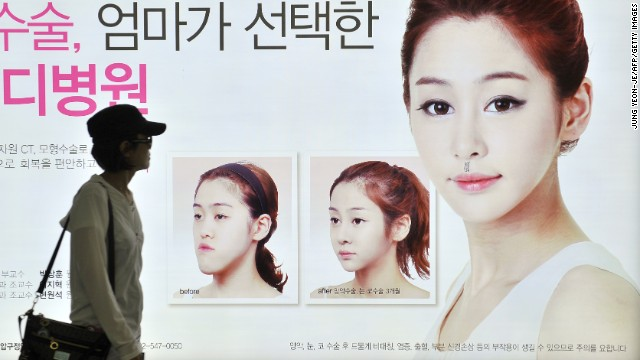 "Would-be-swans from around the world flock to South Korea on plastic surgery ""medical tours,"" not only for the superb results, but also for the good deals. Outdoor advertisements for plastic surgery choke the Beauty Belt area in Gangnam. This one reads: ""The plastic surgery clinic your mom chose for you."""