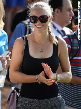 Wozniacki was all smiles as she followed McIlroy round the course. She is in Dubai beginning her preparations for the new tennis season. Her appearance confounded stories that the pair were no longer an item.