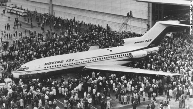 Crowds in Seattle gather for the first viewing of the Boeing 727 jet in December 1962. The aircraft's first flight would take place on February 9, 1963. The 727 is credited with opening the door to domestic travel for millions of everyday Americans.