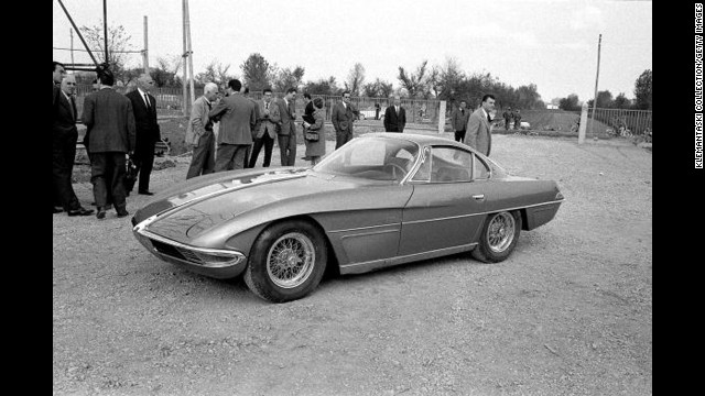 The Lamborghini 350GTV with the body by Franco Scaglione is launched at the Lamborghini Factory, Sant'Agata, Italy, in October 1963. Among the onlookers, with white hair and light-colored jacket, is Piero Taruffi, winner of the last Mille Miglia in 1957.