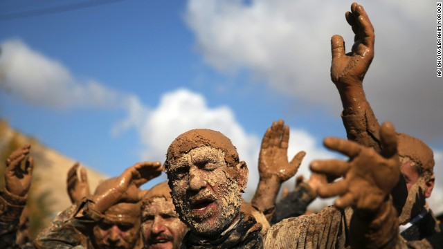 NOVEMBER 15 - BIJAR, IRAN: Shiite Muslims cover themselves in mud during Ashura rituals. The holiday marks the death of Imam Hussein, the grandson of Islam's Prophet Muhammad and one of Shiite Islam's most beloved saints. Ashura celebrations are vital to the Shiite minority, who, unlike the Sunni, believe he is the rightful successor of Mohammed.