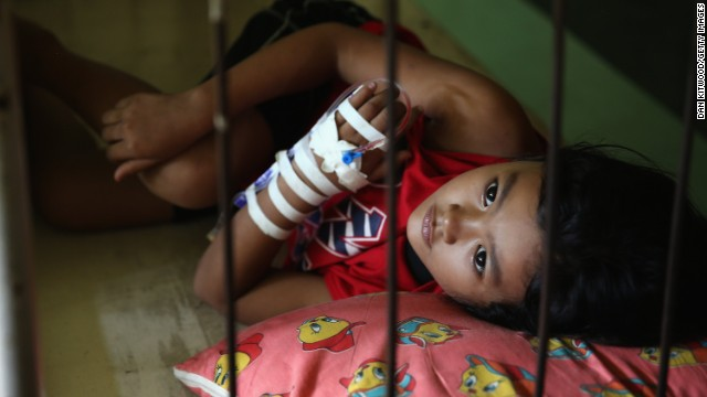 A young girl lays in bed awaiting treatment in a Tacloban hospital on November 15, in Leyte, Philippines.