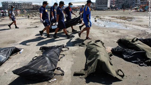Search and retrieval teams carry a body bag in Tacloban on November 15.