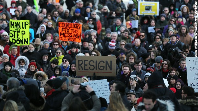 Hundreds gather in Toronto's Nathan Phillips Square on November 13 to call for the Mayor to resign.