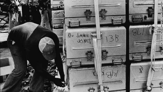 Aluminum coffins hold the remains of some the Jonestown massacre victims in Guyana on November 23, 1978.