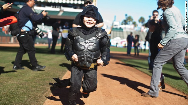 Leukemia survivor Miles Scott dressed as BatKid, runs the bases at AT&T Park in San Francisco on November 15, 2013.