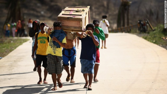 Men carry a coffin toward a Leyte cemetery