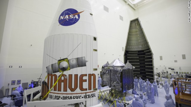"Engineers and technicians work on MAVEN at NASA's Kennedy Space Center in Florida. ""After 10 years of working on this, I can't tell you how excited I am to see this finished spacecraft ready to go,"" said the mission's principal investigator, Bruce Jakosky."