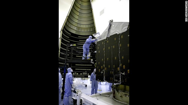 Workers on November 2 get MAVEN ready to be placed inside the nosecone that will protect it during launch. NASA says the project will cost $671 million.