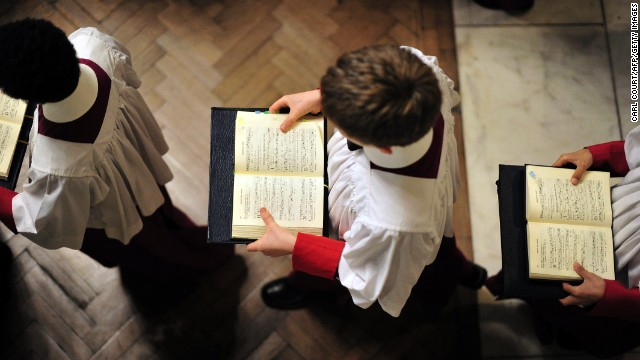 Choir boys carry hymnals November 15 during a Mass for typhoon victims at Westminster Cathedral in London.