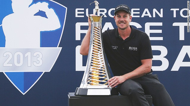 Henrk Stenson with the spoils of his victory at the World Tour championship in Dubai after a stunning last day display,