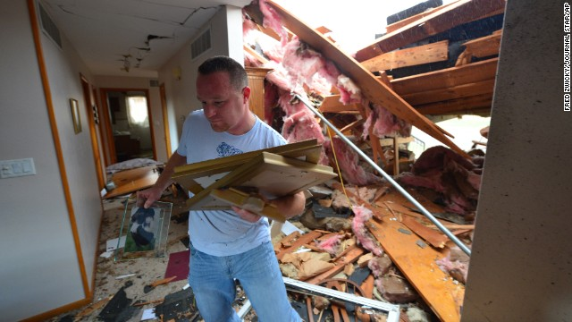 Josh Ramsey recovers items from the house of a family friend after a tornado tore through the north end of Pekin, Illinois, on November 17.