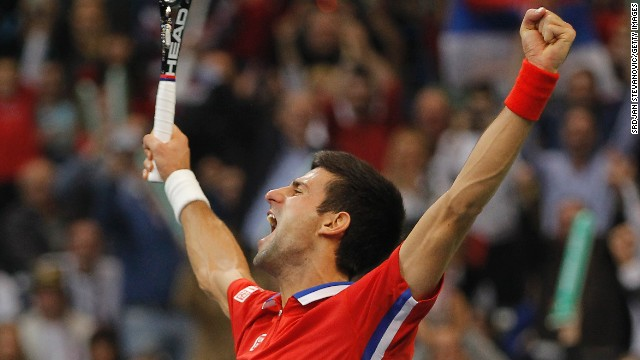 Novak Djokovic celebrates his straight sets victory over Tomas Berdych to draw Serbia level with the Czech Republic in the Davis Cup final.at 2-2.
