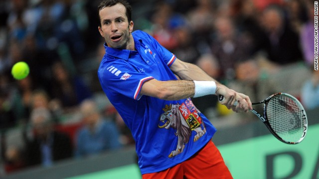 Radel Stepanek is the study of concentration as he hits a double handed back hand on his way to victory in the deciding singles rubber against Lajovic.