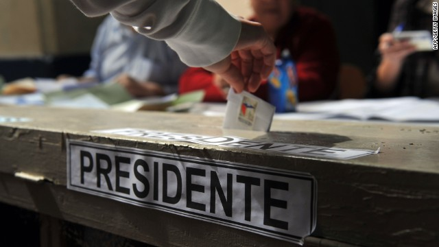 A woman casts her vote at a polling station during general elections in Santiago on November 17, 2013.