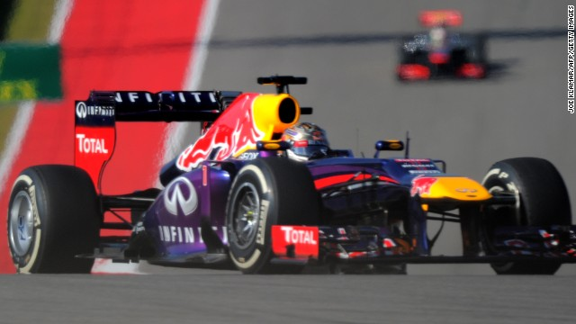 Vettel in splendid isolation in his Red Bull as he takes charge of the United States Grand Prix in Texas.