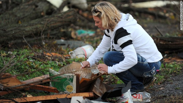 Maranda Souders picks up a crystal bowl and cup while searching through debris from her grandmother's home in Brookport, Illinois, after a tornado hit the small town in far southern part of the state on November 17.